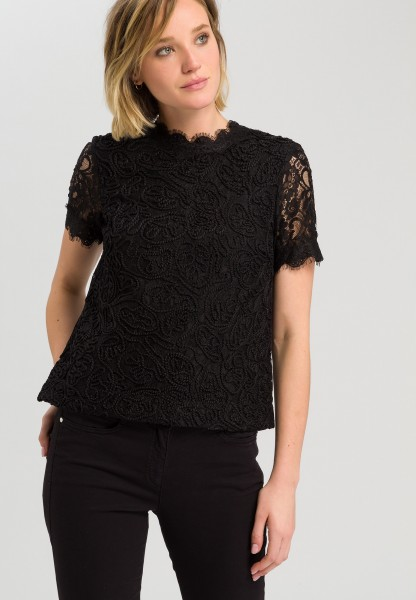 Blouse made of embroidered lace