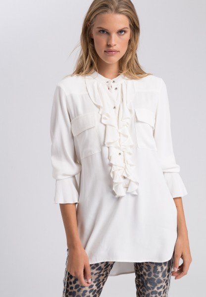Long blouse with trumpet sleeves