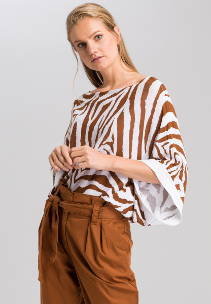Poncho sweater with tiger pattern
