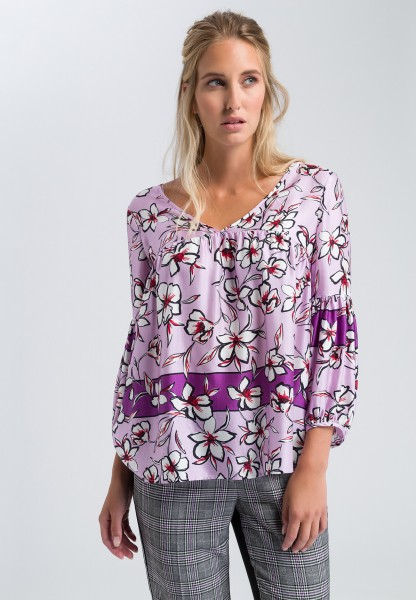 Tunic blouse with a floral print