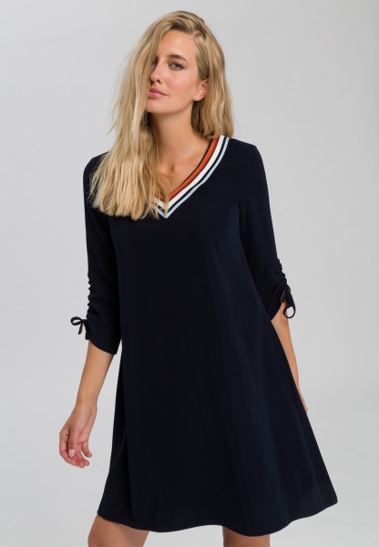 Dress with striped V-neck