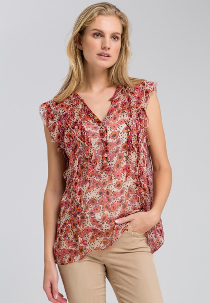 Flounce blouse with a floral print