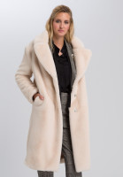 Coat in cuddly fur look