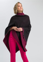 Knit poncho with writing elements