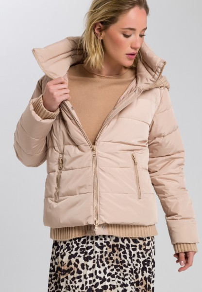 Quilted jacket with knitted details