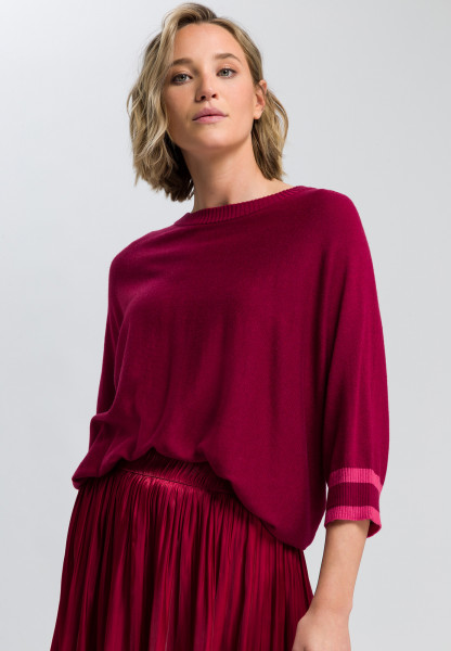 Poncho sweater with contrasting cuffs
