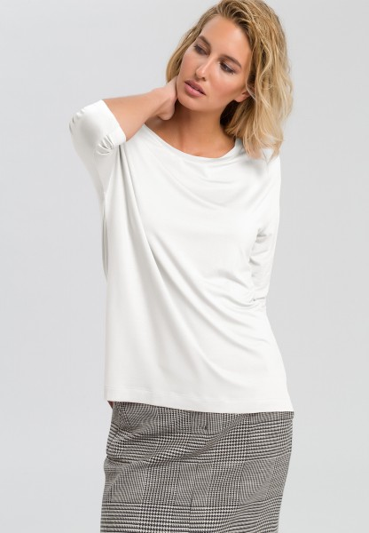Shirt with overlapping shoulders