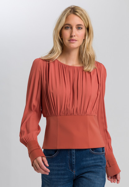 Blouse with ripple effect