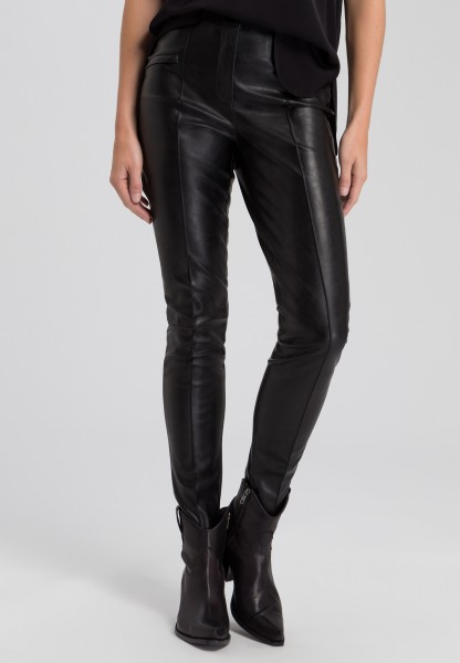 Imitation leather trousers with zip-fastening pockets