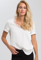 Blouse with lace neckline