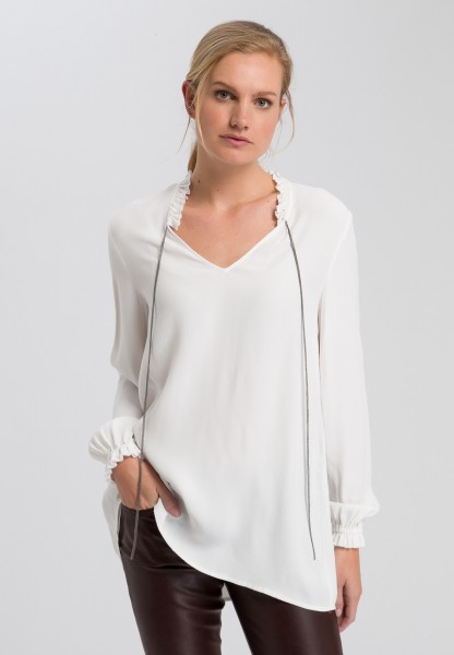 Blouse with metal chain strips