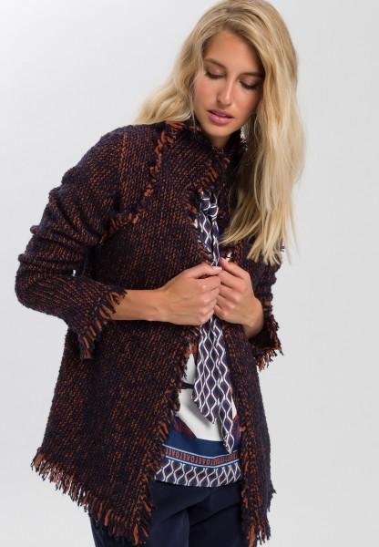 Knitted jacket with fringe details