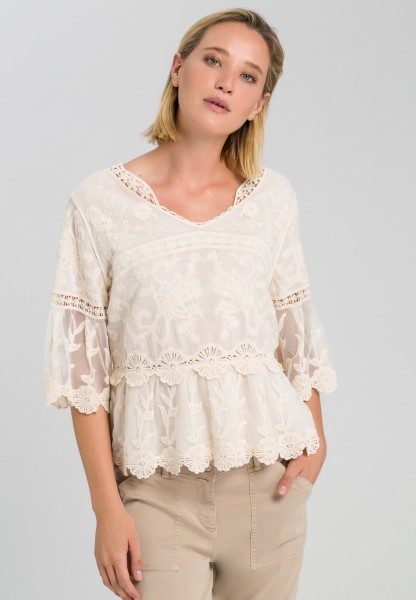Lace top with trumpet sleeves