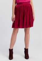 Mini skirt of gleaming material