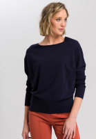 Poncho sweater with visible seams