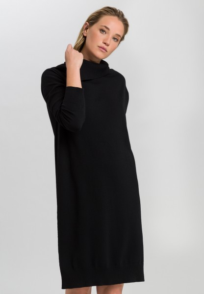 Knitted dress with asymmetric rolled collar