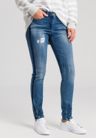 Blue jeans with side stripes and destroyed effects