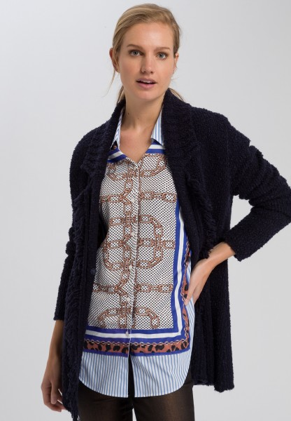 Knitted coat with fringed hem