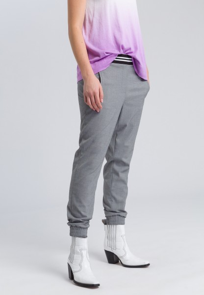 Track pants with stripes on the waistband