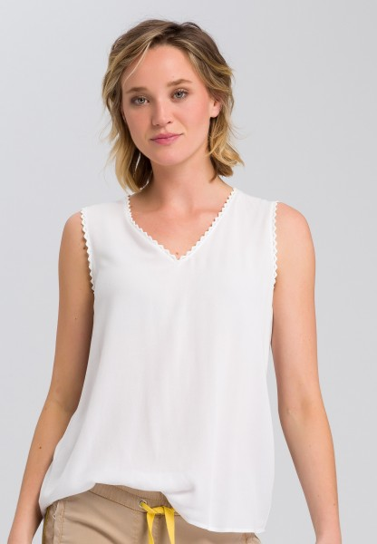 Blouse top with pointed edge