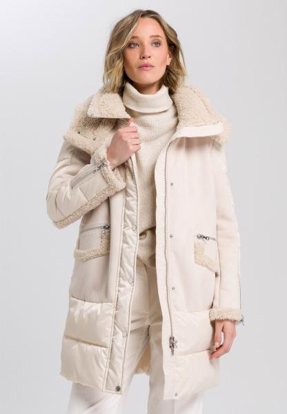 Outdoor coat with details in fur look