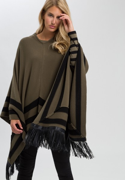Knitted cape with imitation leather fringes
