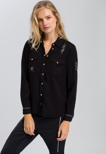 Blouse with shiny applications