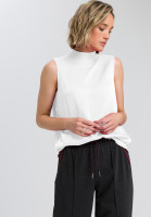Satin top with knitted collar and jewellery decoration