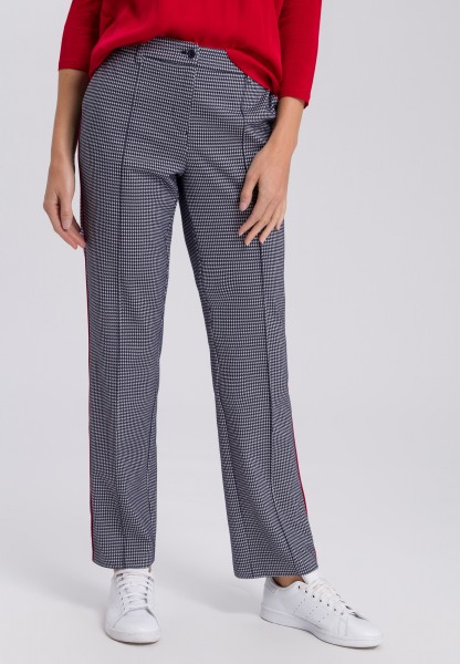 Trousers in dog-tooth check with contrasting details