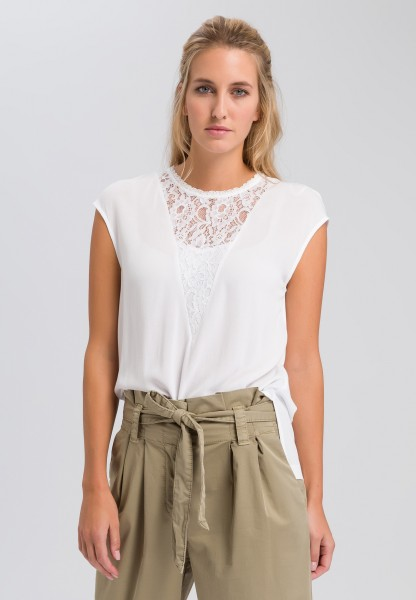Blouse top with tip insert