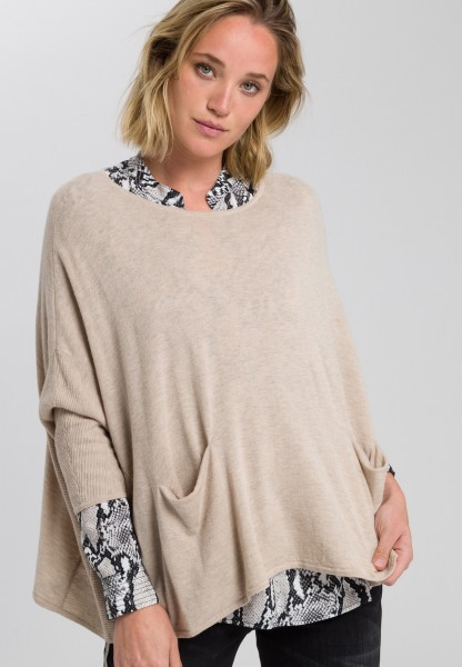 Jumper in poncho style
