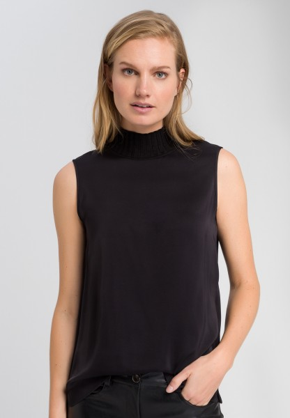 Blouse top with knitted stand-up collar