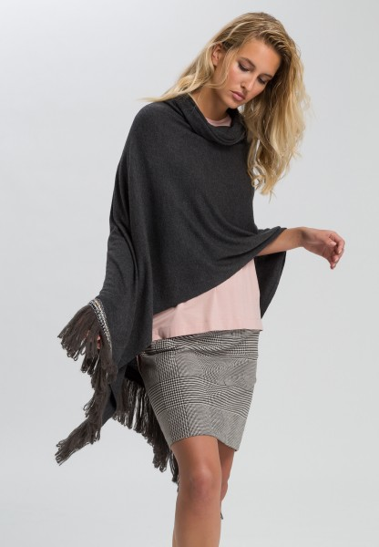 Poncho with jewelled hem